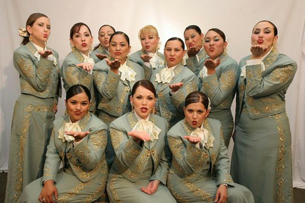 Promotional group photo of America's first all-female mariachi band: Mariachi Reyna de Los Angeles. Since 1994, this 12-member group has been taking on a male-dominated musical tradition and building the popularity of mariachi music.