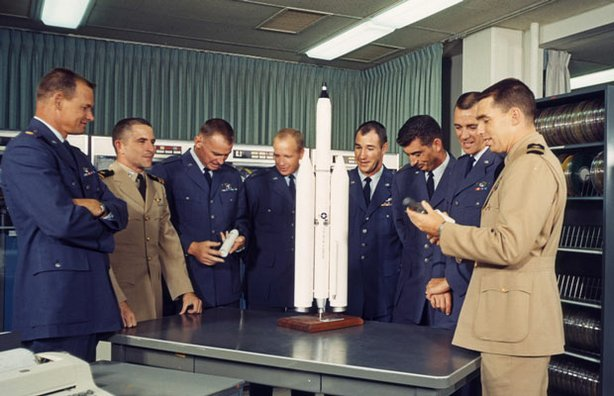 Pictured (l-r): Al Crews, Richard Truly, Richard E. Lawyer, James M. Taylor, Francis G. Neubeck, Michal J. Adams, Lachlan Macleay and John L. Finley. After being selected for the Manned Orbiting Laboratory (MOL) program, MOL's first crew prepares for their intensive training program.