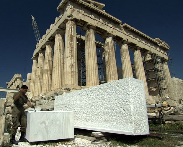 A mason carving a marble block during the Greek government's $10 billion Part...