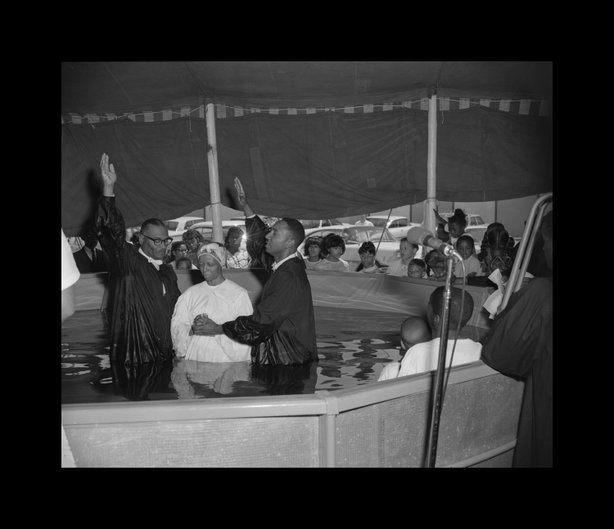A baptismal scene shot in San Diego by Norman Baynard.