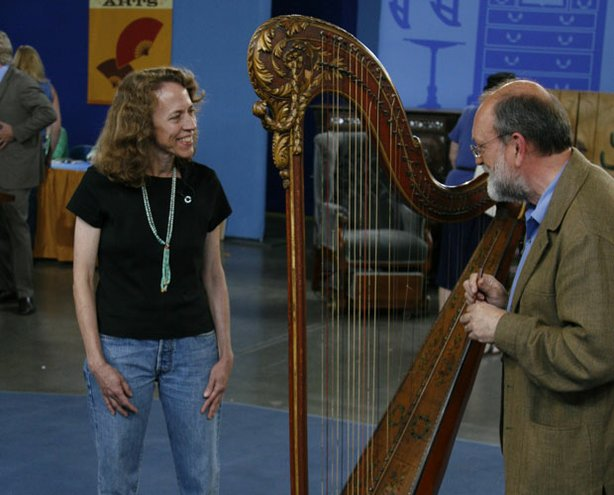 "At ""Antiques Roadshow"" in Tucson, Arizona, appraiser Andrew Dipper of Givens Violins plucks this 18th-century French harp out of the crowd. The owner, herself a harpist, discovered the instrument at an estate sale while she searched for a harp for one of her students. In a hurry, she determined the piece was too much of an antique for the girl and left. Unable to stop thinking about it, she called the buyer and arranged to purchase the harp for $2,400. Made in 1776 by French harp maker Jean-Henri Naderman, who built harps for the aristocracy and Queen Marie Antoinette herself, the instrument could command a value of $60,000."