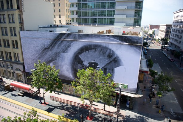 Artist JR's work on the corner of C Street and Fifth Avenue in San Diego.