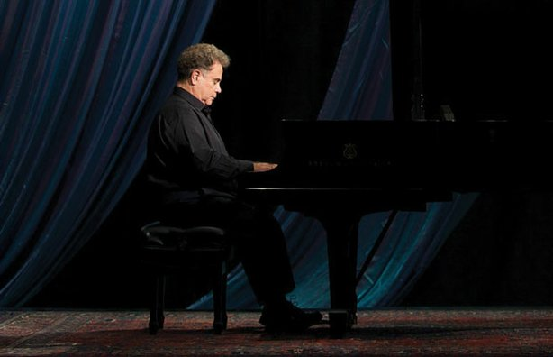 "The distinguished American pianist Jeffrey Siegel playing on stage. Siegel presents ""Keyboard Conversations,"" a unique, concert-plus-commentary format in which he speaks to the audience about the music before performing each work in its entirety."