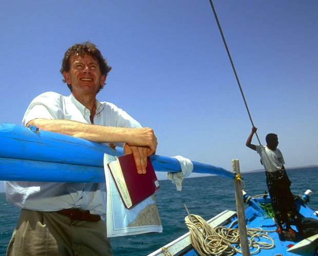 Michael Wood receives an assist from a local Eritrean mariner in in the water...
