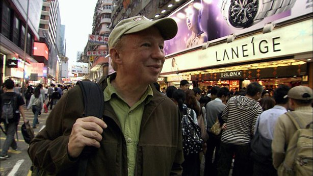 Adventure travel author Richard Bangs braves the nightly throngs of shoppers in the Mong Kok district of Kowloon.