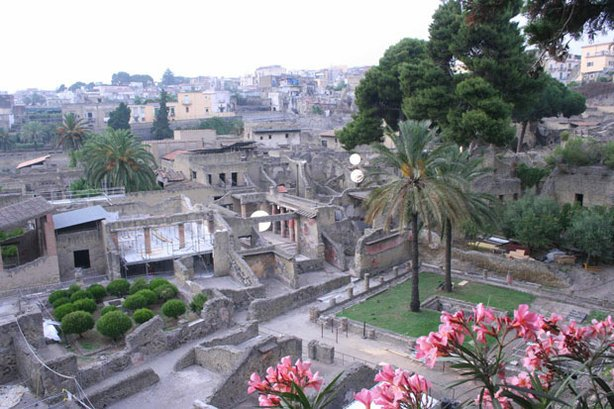 Ariel view of the ruins of Herculaneum, a seaside town in Italy's Bay of Naples. This program explores the ruins of Herculaneum, a city buried and frozen in time by the eruption of Mount Vesuvius in 79 A.D.
