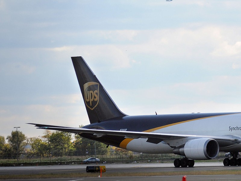 A UPS cargo plane rests on the tarmac after a suspicious package was found on...