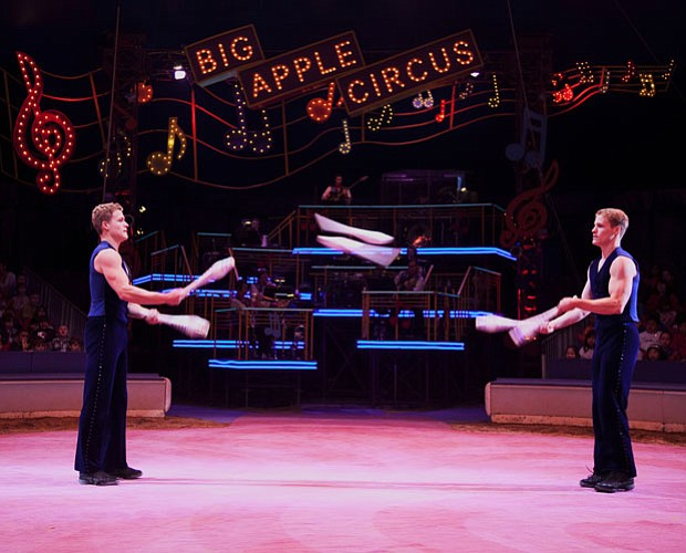 Jake and Marty LaSalle perform a juggling act. They're mirror images of each ...