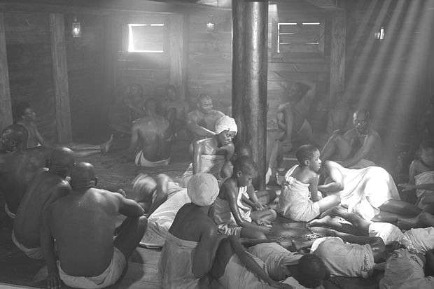 A reenactment scene of slaves on a ship from