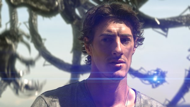 "Eric Balfour and tentacled alien in ""Skyline."""