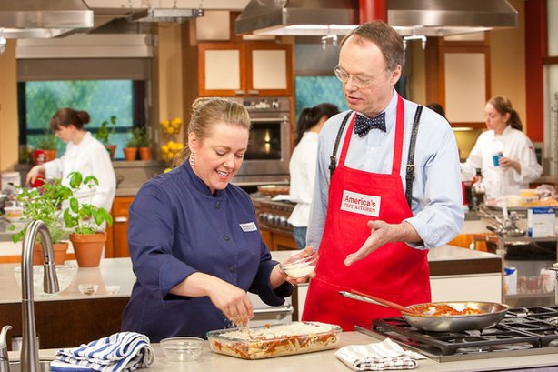 Host Christopher Kimball in the test kitchen with cook Julia Collin Davison