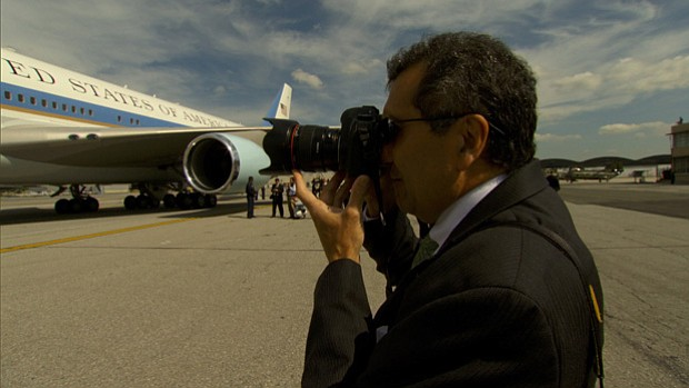 Pete Souza takes a photo of President Obama boarding Air Force One.