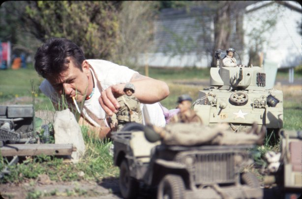 "Mark Hogancamp setting up for a photo in the documentary ""Marwencol."""