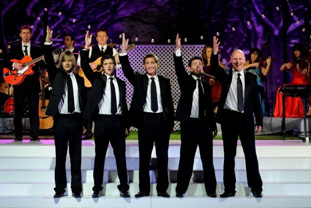 Promotional photo of Celtic Thunder on stage for