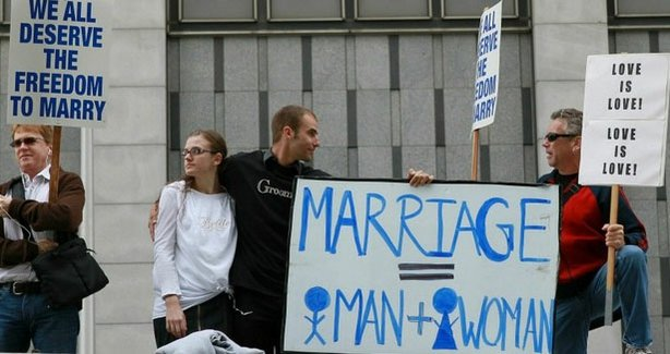 Supporters of Proposition 8, the California measure that restricts legal marriage to heterosexual couples, stand between opponents of the measure in San Francisco in August during one of the many legal proceedings in the case.