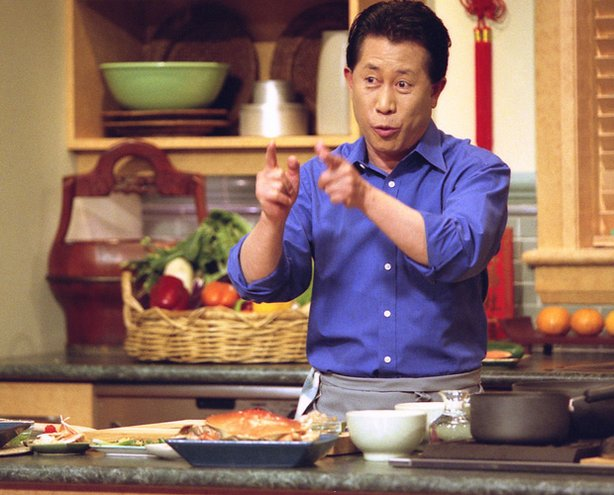 Promotional photo of Martin Yan cooking in the kitchen