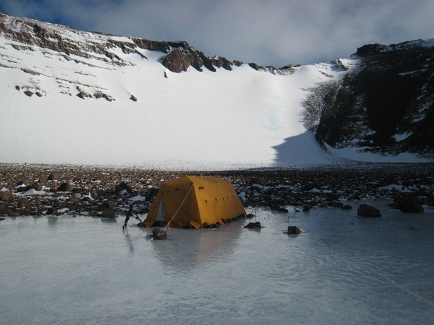 A tent below the headwall of a glacier at Dave Marchant's field camp in Beaco...