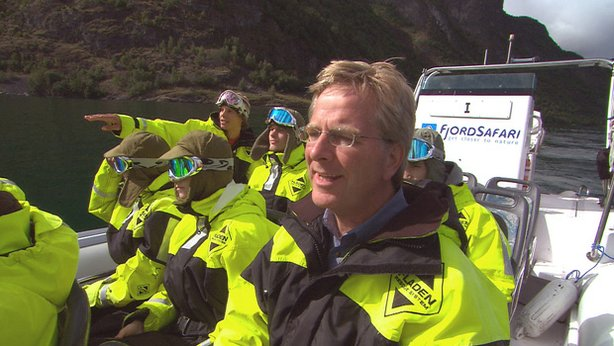 Rick Steves with FjordSafari. FjordSafari takes little groups out onto the fjord in small, open Zodiac-type boats with an English-speaking guide. Participants wear full-body weather suits, furry hats, and spacey goggles. The shorter Flåm–Gudvangen–Flåm tour focuses on the Nærøyfjord, and gets you all the fjord magnificence you can imagine. A longer version includes a stop in sleepy Undredal.