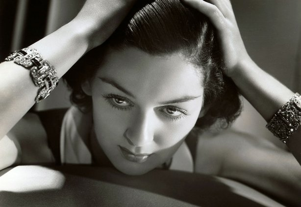 "Promotional photo of Rosalind Russell, a legendary actress of Hollywood's Golden Era. Russell was the star of ""Auntie Mame,"" ""His Girl Friday,"" ""Gypsy"" and scores of other memorable films and Broadway shows. An innovative and highly talented performer, Russell earned four Oscar nominations, won five Golden Globes and a Tony Award."
