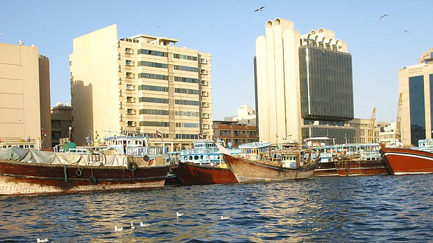 Wooden boats known as dhows are used in trade between Dubai and Iran. The emi...