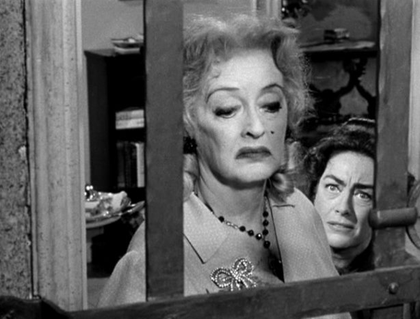 "Joan Crawford and Bette Davis star in the 1962 Robert Aldrich film ""Whatever ..."