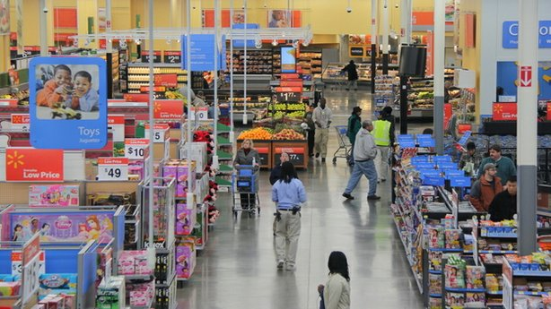 Groceries sit on shelves next to a variety of other goods at a Walmart in Fai...