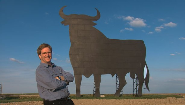 Rick Steves stands beside his favorite bull board, Spain.