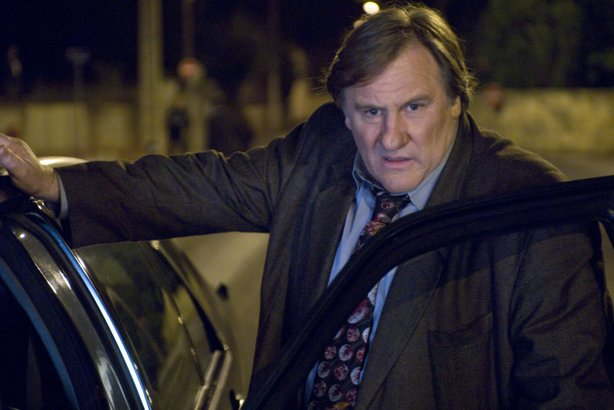 "Gerard Depardieu as ""Inspector Bellamy."""