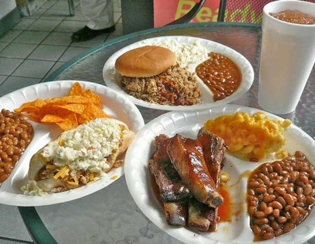 A table covered with plates of food from Midway BBQ in Buffalo, South Carolin...