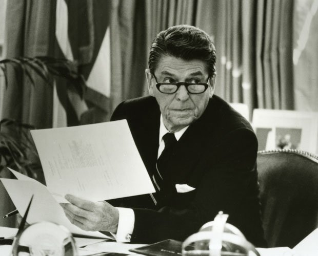 President Ronald Reagan at his desk in the White House.