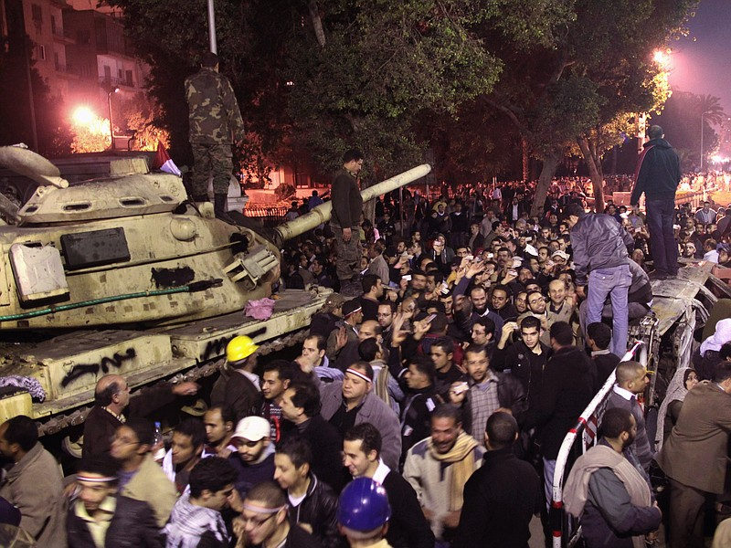 People enter Tahrir Square as news of the possible resignation of Egyptian Pr...