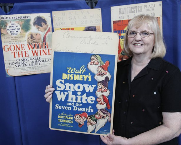 "At ""Antiques Roadshow"" in Des Moines, this guest shows off a number of beautifully preserved movie window cards from the 1920s though the 1950s, including this original card used for the 1937 release of ""Snow White and the Seven Dwarfs."" This impressive collection from Hollywood's Golden Age is valued at $25,000 to $28,000."