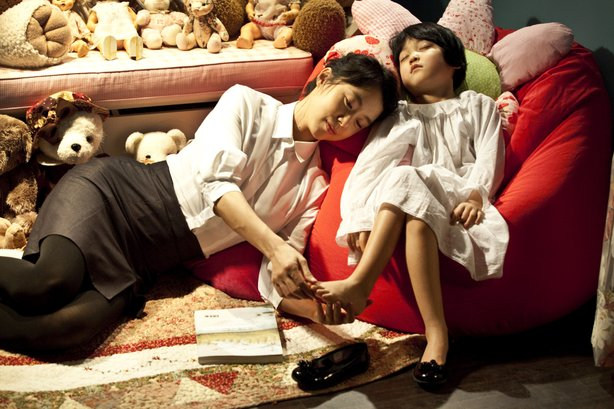 "Jeon Do-Youn and Ahn Seo-hyeon share a quiet moment in ""The Housemaid."""