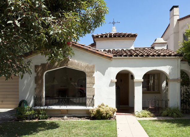 This charming 1930s Spanish Colonial Revival home located in the picturesque ...