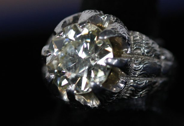 "At ""Antiques Roadshow"" in Des Moines, Stuart Whitehurst appraises a circa 1925 diamond and platinum ring, originally purchased in 1926 for $1,000. Created for a man to wear, and originally owned by an early 20th century magician, it is valued at $60,000 to $80,000."