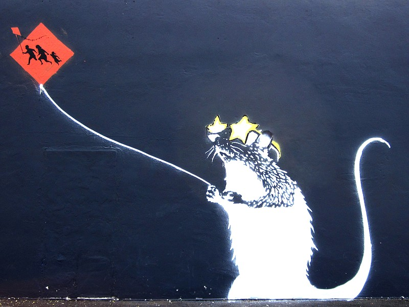 A close up of the rumored Banksy stencil on the side of Bull Taco shop in Oce...