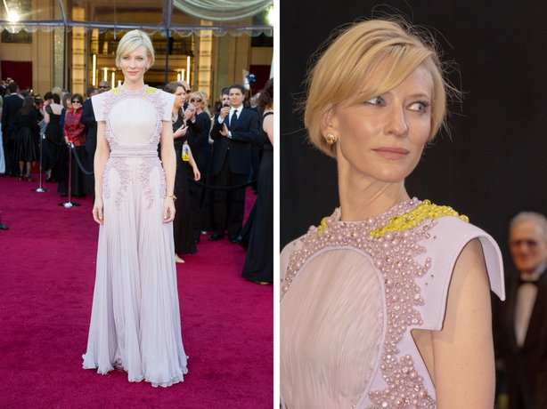 Cate Blanchett in a truly odd gown that had what looked like an empty oval fram on her chest and vomit on her neck.