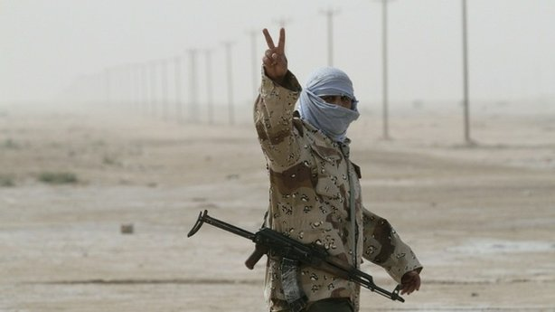 "A Libyan rebel soldier flashes the ""V for victory"" sign as he prepares for battle in the eastern city of Ajdabiya on Wednesday."