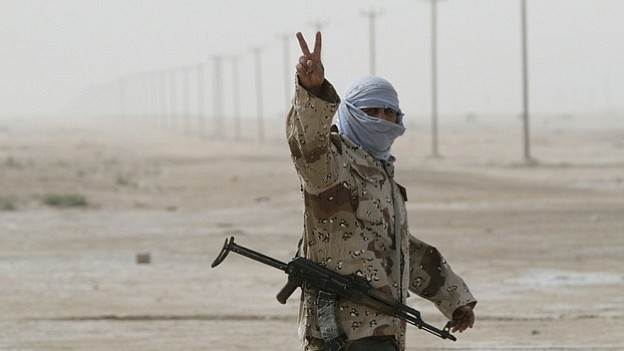 A Libyan rebel soldier flashes the