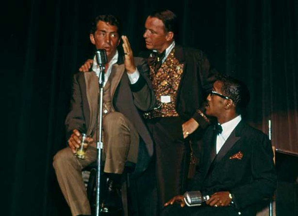 Frank Sinatra, Sammy Davis Jr. and Dean Martin perform on stage together