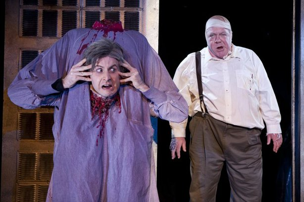 "Jesse Merlin loses his head as Dr. Hill and George Wendt is Dean Halsey in ""Re-Animator: The Musical."""