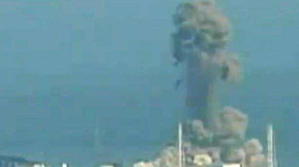 A screen grab taken from news footage by Japanese public broadcaster NHK shows the moment of a hydrogen explosion at the Fukushima No. 1 nuclear power station number three reactor on Monday.