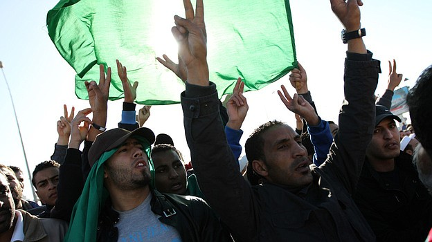 Men in Tripoli join in the part-protest, part-funeral for civilians said to h...