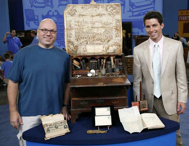 "The ""Antiques Roadshow"" event in Dallas, Texas, uncovers a virtual archeological dig in a desk when this guest (left) brings in an heirloom 18th-century miniature whose drawers are stuffed with 300 years of family documents and history. Appraiser Andrew Brunk of Brunk Auctions leaves the owner overjoyed when he values this treasure trove at $100,000."