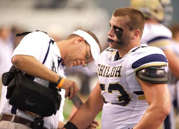 Samuel Harvill from Shiloh Christian High School gets his elbow taped during a game against the Euless Trinity Trojans at Cowboys Stadium in Dallas in 2010.