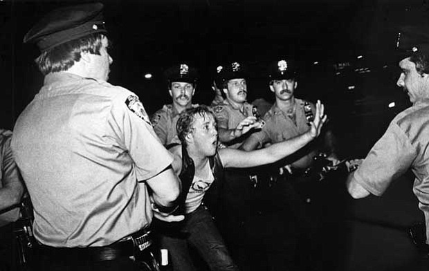 Lesbian protester and cops, June 28, 1969. When police raided Stonewall Inn, ...