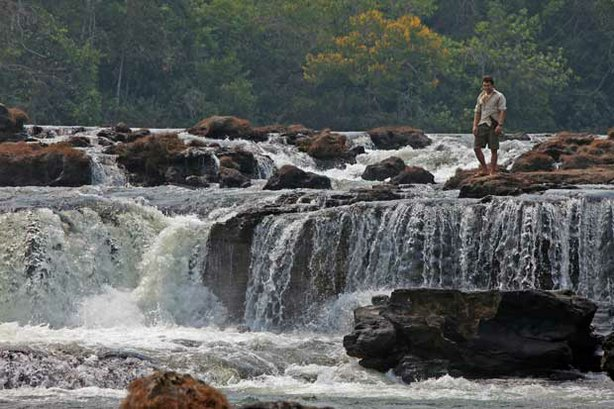 Niall McCann, explorer/biologist, at Kamukuakua Falls in the Mato Grosso, Bra...