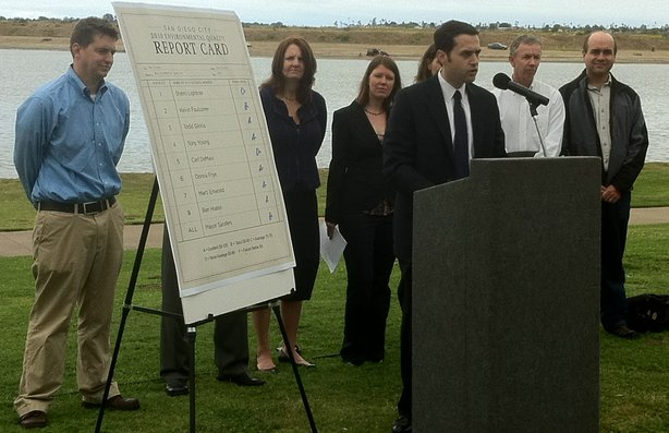 San Diego environmental groups stand next to a report card that grades the mayor and city council on votes taken on environmental issues, on April 20, 2011 in San Diego, California.