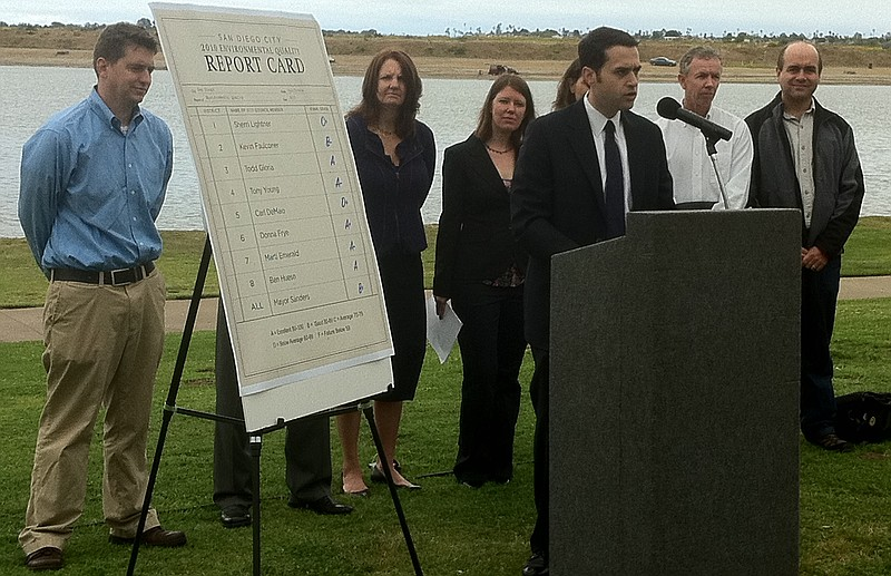 San Diego environmental groups stand next to a report card that grades the ma...