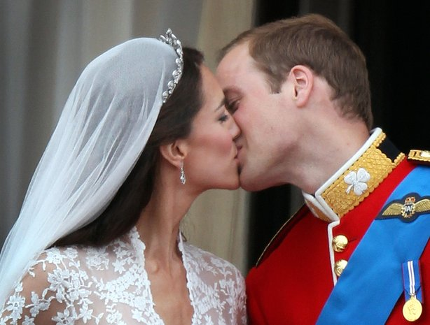 Their Royal Highnesses Prince William, Duke of Cambridge and Catherine, Duchess of Cambridge kiss on the balcony at Buckingham Palace on April 29, 2011 in London, England.